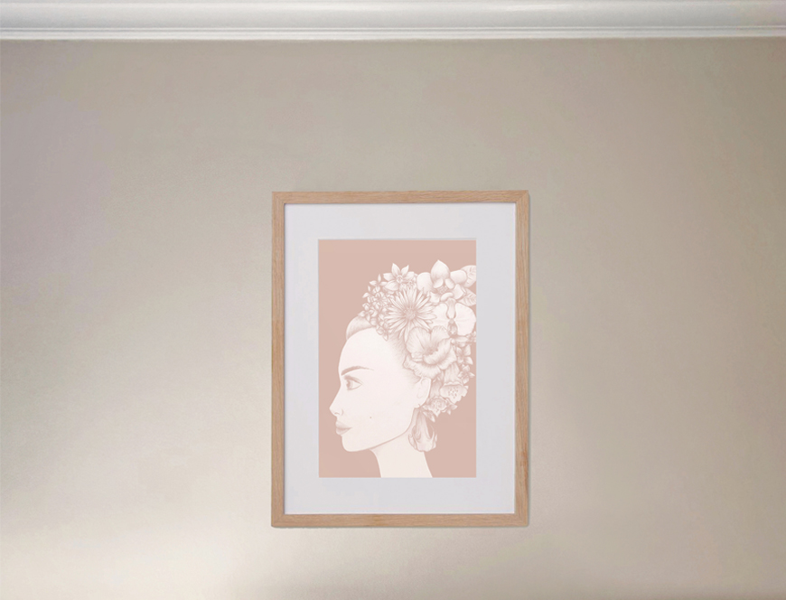 Cream wall with floral wall art portrait on wall.